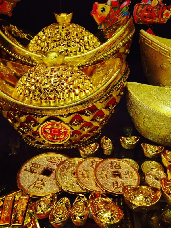 Money! These ancient coins and taco-shaped gold thingies represent wealth in the coming year. A New Year's must-have!