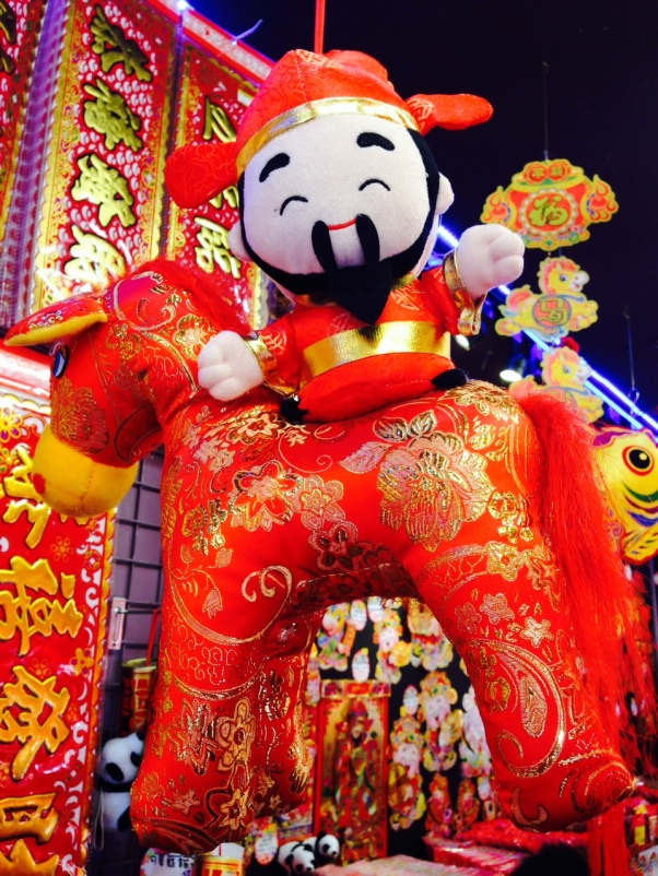 The Chinese wealth god is riding a horse to celebrate the Year of the Horse!